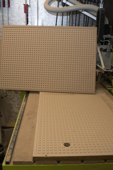 Upper board (spoilboard) from underneath, and the upper surface of the lower portion of the vacuum table